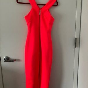 Bright pink midi with gold zipper in the back